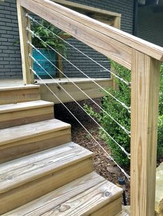Today we have a DIY for those of you that may want to modernize your deck. Cable railing for a modern look! This works out perfect for when you are having a new deck built. When we purchased our home, the deck was not up to standard Cable Stair Railing, Outdoor Stair Railing, Deck Railing Design, Deck Stairs, Deck Railings, Deck Design, Deck Railing Ideas Diy, Horizontal Deck Railing, Porch Ideas