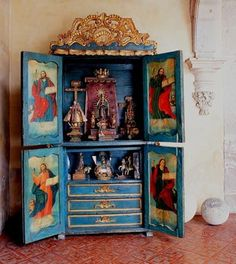 Home altar in a dedicated cabinet from the Spanish colonial period. The 4 apostles are depicted on the doors, our virgin of Guadelupe, our lady of San Juan los Lagos, st Michael, and Nino atocha among others Religious Icons, Religious Art, Religious Paintings, Religion, Mundo Hippie, Catholic Altar, Prayer Corner, Mexican Furniture, Home Altar