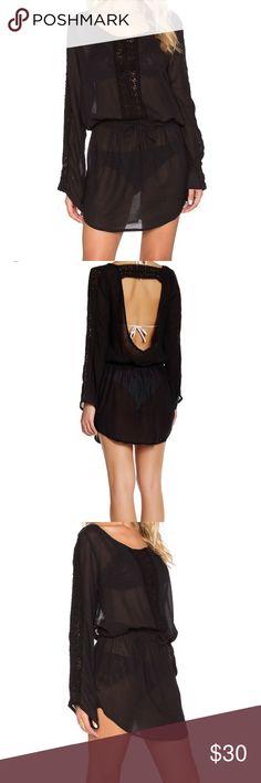 "Vitamin A Daydreamer Black cover up dress Sz M 8 Beautiful day dreamer black gauze crochet cover up dress , back large drop key hole and long sleeves.   Sz Medium   Approx Measurements   armpit-armpit flat lay 185""  shoulder-hem 31.5"" Vitamin A Swim Coverups"