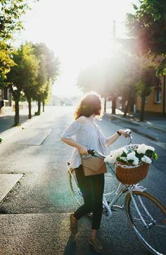 Be the girl who rides with flowers in her basket...