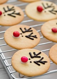 Rudolph Cream Cheese Sugar Cookies -- adorable and so simple.  Make the little ones' holiday magic and let them put on the noses!