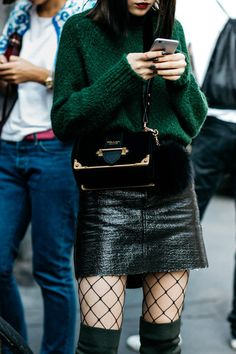 skirt mini skirt vinyl leather skirt black leather skirt black skirt tights net tights fishnet tights sweater green sweater turtleneck bag black bag tumblr fall outfits sexy outfit sweater weather suede boots box bag prada prada bag designer bag vinyl skirt