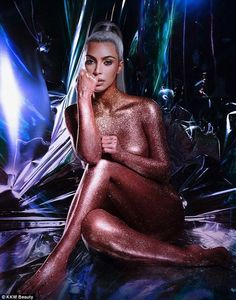 Show-stopping: In a bid to promote her KKW beauty line, Kim Kardashian stripped completely nude and covered her body in bronzed glitter