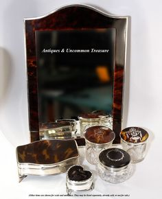 Victorian to Edwardian era sterling silver and tortoise shell vanity items, mirror, dressing table boxes and jars, and jewelry boxes - all available at Antiques & Uncommon Treasure