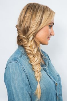 This braid hairstyle is part dutch braid, party fishtail braid. The two combine to create the ultimate weekend updo. Get the full tutorial when you click! We promise it's easy.
