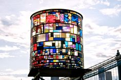 On the night of June 3rd, 2012, Tom Fruin's newest sculptural artwork, Watertower, was installed on a rooftop near the Manhattan Bridge in DUMBO. The color