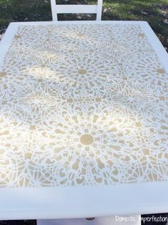 A DIY stenciled dining table using the Stephanie's Lace Allover Stencil from Cutting Edge Stencils in metallic gold. http://www.cuttingedgestencils.com/lace-stencil-wall-decor-stencils.html