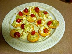 Ritz crackers with diced tomatoes, feta, and mozzarella!
