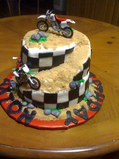 Dirt Bike Cake - This is a cake I did for a friends little boy.  He was turning 2 and loves dirt bikes and he got one for his bday.   Everything is edible except the dirt bikes of course...