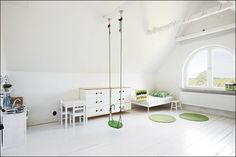 White walls, floor and furniture. Green contrast. Very minimalistic.