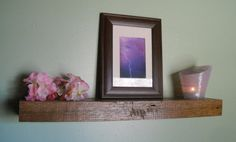 reclaimed rustic floating barn wood shelf with shade-of-purple accents