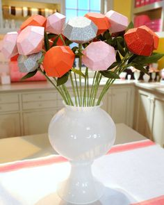 Diamond shaped paper roses...perfect for a bridal shower!  {tutorial and template at Martha Stewart}