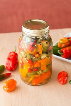 A quick and easy recipe for pickling your chili peppers so you can preserve them throughout the year. Enjoy them on anything. Perfect for any type of chili pepper. Pickled Pepper Recipe, Pickled Hot Peppers, Pickling Peppers, Pickling Vegetables, Quick Pickled Vegetables, Pickling Jalapenos, Veggies, Types Of Chili Peppers, How To Pickle Peppers