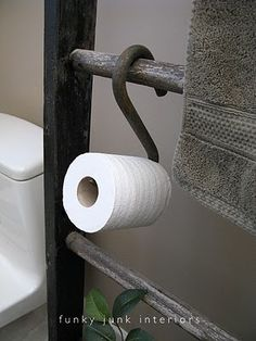 yeah.... hook and an old ladder in the bathroom for toilet rolls. Just figured out what kind of TP holder I'm going to use. Now I just need to find the hook.