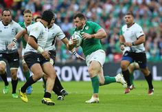 Cian Healy Photos Photos - Cian Healy of Ireland takes on the Romania defence during the 2015 Rugby World Cup Pool D match between Ireland and Romania at Wembley Stadium on September 27, 2015 in London, United Kingdom. - Ireland v Romania - Group D: Rugby World Cup 2015