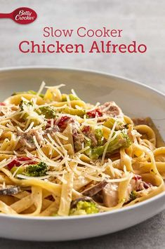 Our comforting-yet-fresh take on chicken Alfredo has plenty of veggies, creamy sauce and tender, flavorful chicken. Thanks to the slow cooker, it only requires 25 minutes of prep. Slow Cooker Alfredo Chicken, Chicken Alfredo, Yummy Chicken Recipes, Yummy Recipes, Slow Cooker Recipes, Cooking Recipes, Healthy Foods, Healthy Recipes, Dinner Is Served