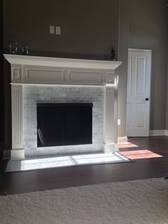 Marble Subway Tile Fireplace   ... Carrara marble subway tile fireplace. Love it. #decor #fireplace #tile