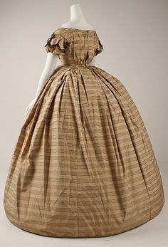 3/4 view of plaided silk, infant bodice, box pleated skirt, short sleeves; American, ca 1860. Note the bodice's back opening. MET