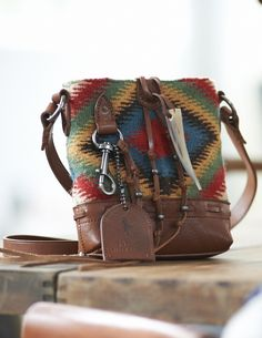 This charming wool Polo Ralph Lauren cross-body bag features a bright  serape-inspired f91eb63b6d065