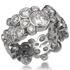 Scattered Bezel Diamond Wedding Band 1 -      This unusual diamond wedding band consists of scattered bezels in different sizes. Ideal cut diamonds.        Please inquire for price in different sizes and widths!