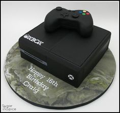 xbox cake This cake was for a young gent who knows his stuff and wants to be a game writer, and THIS apparently is the 2014 model out later this year (Oh, and the marbled board I fell a little bit in love with :) ) choc mud with RKT controller on a Birthday Cakes For Men, Funny Birthday Cakes, Teen Boy Birthday Cake, Teen Cakes, Cakes For Boys, Bolo Xbox, Xbox One Cake, Playstation Cake, Video Game Cakes