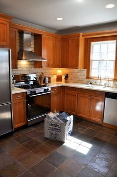 Kitchen | Oak Cabinet | White Subway Tile backsplash | Dark