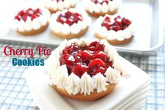 Fresh baked deep dish sugar cookies topped with buttercream frosting and cherry pie filling make these cookies a new favorite!