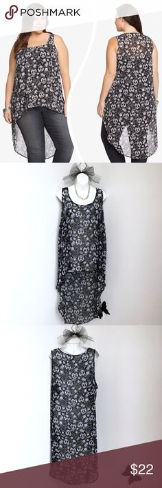 """Torrid Floral Skull Extreme Hi-Lo Tank Top This is a great black and white sleeveless, semi-sheer, chiffon tank with a floral skull print and an extreme hi-lo hem. No stretch. There is a slim material run in front, you have to be looking for it to see it. See pic. Material is polyester.  Size: Torrid 1 or 14/16 - Runs big. Bust: Approximately 48"""" Length: Approximately 29"""" Shortest Hem Length: Approximately 45"""" Longest Hem  In great condition. Torrid  Tops"""