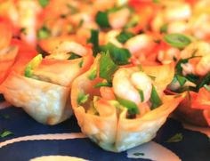 Shrimp Remoulade Won Ton Appetizers. 1 lb. boiled shrimp, seasoned; molded baked wonton skins; remoulade sauce; finely chopped parsley.  Chop each shrimp into 3 to 4 chunks.  Mix with remoulade sauce.  Spoon into cooled wonton cups.  Sprinkle with finely chopped fresh parsley.