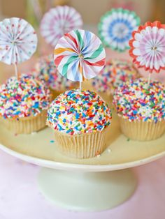 Cute cupcakes with sprinkles and pin wheels #cupcakes #cupcaketoppers #sprinkles