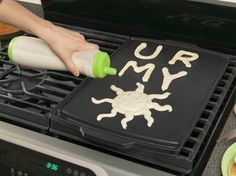 a pancake pen, the best Sunday morning kitchen gadget EVER!  makes my son's complicated shape requests much easier :-D