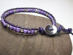 Single wrap bracelet, using purple leather, purple seed beads and silver tone accent beads, finished with a silver tone button.