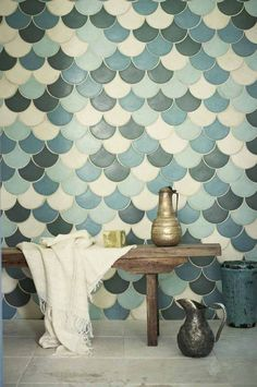 fish scale tiles bathroom with blue and green tile walls