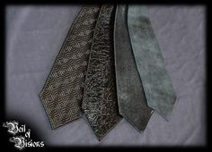 Get a tie choker that stands out! 4 different textures to choose from. From left: 1. Biomech, 2. Crinkle PVC, 3. Snakeskin PVC, 4. Denim PVC. £25