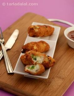 A snack prepared in a jiffy for hungry school returned kids. Deep-fried bread rolls stuffed with a spicy spring onion and paneer filling. Serve these rolls hot with hot garlic sauce.