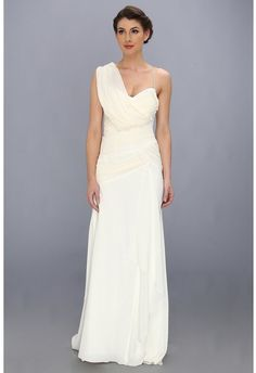 Glide gracefully down the aisle in this enchanting Nicole Miller bridal gown. ; Stretch silk crepe de chine gown features shirred silk georgette at bodice and hips. ; Draped detail at right shoulder creates an asymmetrical effect. ; Spaghetti straps frame the sweetheart neckline and meet at Y-back. ; Sweep train provides an elegant finish.