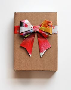Origami bow made from magazine pages.  Might be nice to use these at Christmas - recycling made gorgeous!