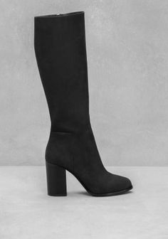 Elegant in their simplicity, these high shaft boots are crafted from matte leather and feature discreet angular seam details.