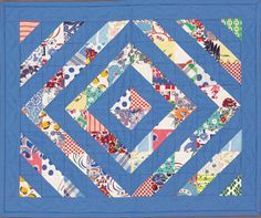 Triangle-squares rotate this way and that to create the overall diamond pattern. A variety of feed sack prints are held together visually by the use of a single solid blue fabric.