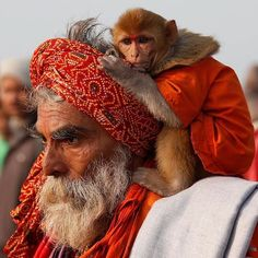 "A Sadhu or a Hindu holy man carrying his pet monkey walks after taking a dip at the confluence of the river Ganges and the Bay of Bengal on the occasion of ""Makar Sankranti"" festival at Sagar Island, south of Kolkata, India.  PHOTO: REUTERS  #sagarisland #kolkata #india #riverganges #bayofbengal #world #etribune #photography #potd #photooftheday #instadaily #instagood #igers"