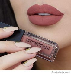 Brown matte lips with long nude nails