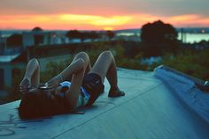 To watch the sunset/sunrise on a roof<3