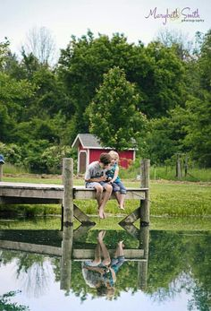 Kids fish n down on the dock back at the lake