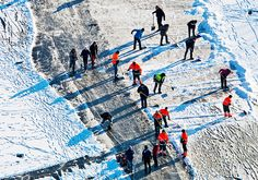 People working hard to prepare the ice for the Elfstedentocht