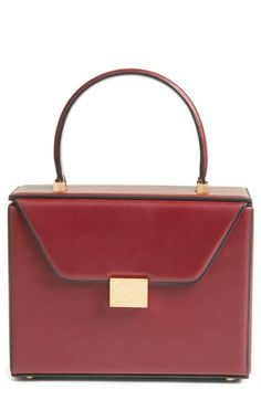 Free shipping and returns on Victoria Beckham Mini Vanity Top Handle Box Bag at Nordstrom.com. Inspired by the clean lines of classic vanity cases, this beautifully structured leather box bag is handcrafted in Italy and polished with textured goldtone hardware.