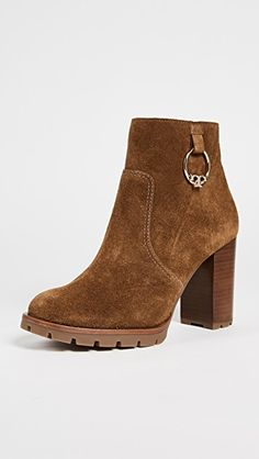 Tory Burch Sofia Lug Sole Booties A polished logo medallion trims the sides of these suede Tory Burch booties. Fall Shoes, High End Fashion, Brown Suede, Everyday Fashion, Wedge Shoes, Fendi, Tory Burch, Booty, Heels