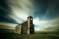 The old Cottonwood Lutheran Church is abandoned on what is now pasture land north of Havre, Montana. © 2010 Todd Klassy