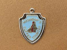Vintage silver MICHIGAN 'S COPPER COUNTRY ENAMEL SOUVENIR TRAVEL SHIELD charm #M
