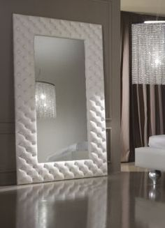 The statement Diva Collection seductive mirror, shown here button upholstered to the highest standard in a fine Italian white leather. Also available in various other leathers, fabrics and sizes on request. Prices vary.