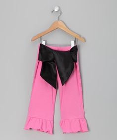 Take a look at this Pink & Black Ruffle Pants - Toddler & Girls by Lil Miss Muffin on #zulily today!